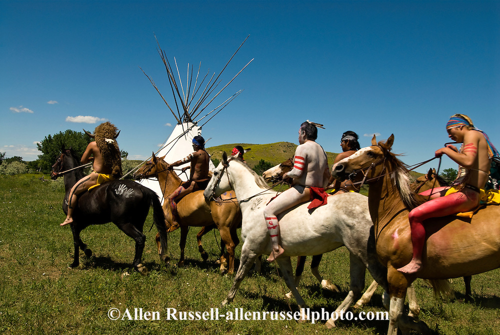 Custers Last Stand Reenactment; Battle of the Little Bighorn; Crow Indian Reservation; Montana; warriors ride to attack General George Custer, Seventh Cavalry.
