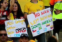 Fans hold up a sign before the match saying - No man left behind South America.<br /> Ecuador are the first South American team to be knocked out of the tournament