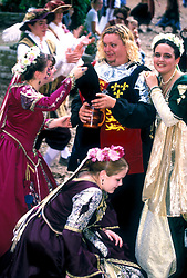 Stock photo of a group of young costumed revelers drinking at the Texas Renaissance Festival in Plantersville Texas