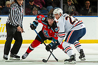 KELOWNA, BC - OCTOBER 12: Ryley Appelt #23 of the Kamloops Blazers faces off against Liam Kindree #26 of the Kelowna Rockets at Prospera Place on October 12, 2019 in Kelowna, Canada. (Photo by Marissa Baecker/Shoot the Breeze)