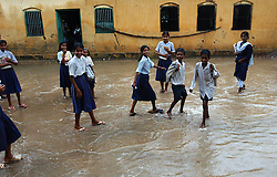 EKANGERSERAI, BIHAR: AUGUST 11:Children leave the Middle School Ekangerserai after monsoon rains flooded the classrooms in this village about 100 kilometers from Patna in the state of Bihar, India August 11, 2003.  Bihar is the poorest state in India and girls often suffer the most because of the poverty, lack of education and opportunities. (Photo by Ami Vitale)