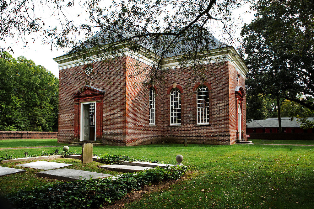 """This perfectly symmetrical central-plan Georgian church was funded by Robert """"King"""" Carter of Virginia, and built in part of his plantation, now in the town of Weems, in 1735.  His tomb and those of some of his wives are on the church property, seen here in the foreground.  Still used for worship, the structure is lovingly restored and maintained by a nonprofit volunteer society."""
