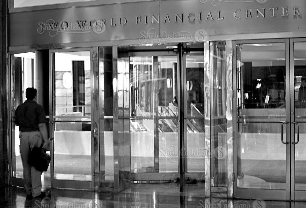 Aug 16, 2002; New York, NY, USA; Man enters the Two World Financial Center through the doors similar to those inside the World Trade Center.  Mandatory Credit: Photo by Shelly Castellano/ZUMA Press. (©) Copyright 2002 by Shelly Castellano