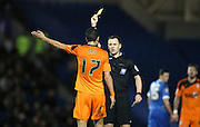 Ipswich Town midfielder Kevin Bru (17) shown a yellow card during the Sky Bet Championship match between Brighton and Hove Albion and Ipswich Town at the American Express Community Stadium, Brighton and Hove, England on 29 December 2015.