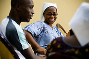 Staff of the NDA health center chat together while sitting outside the center in Dimbokro, Cote d'Ivoire on Friday June 19, 2009. From left to right HIV/AIDS counselor Kevin Kouassi Gallet, Sister Felicité Akossi Kousso.