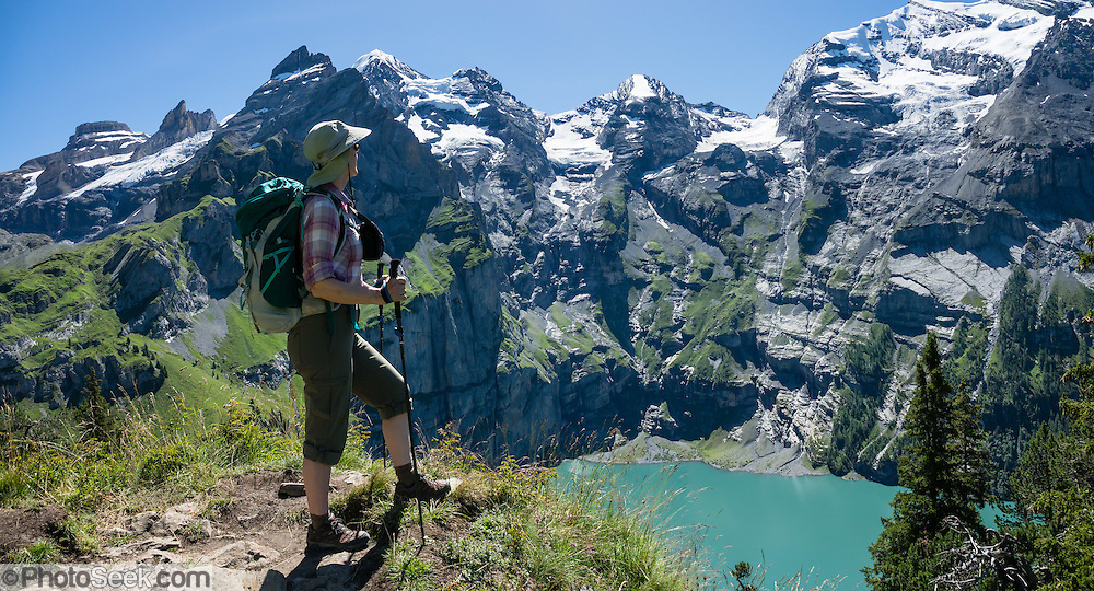 Above the beautiful lake of Oeschinnensee, easily reached by lift from Kandersteg, is a challenging hike traversing steeply up over Hohtürli Pass then down to Griesalp in the remote valley of Kiental, Switzerland, Europe. Ascend 1120 meters and descend 1380 m in 13 km, which feels much longer due to steep, exposed rocky & gravelly slopes. Stairs and ladders assist your footing. Optionally stay overnight in Blüemlisalp hut at Hohtürli Pass. This image was stitched from multiple overlapping photos. For licensing options, please inquire.