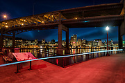 The red glow in this photo is from the giant red OMSI sign on Portland's eastbank. The Portland skyline is visible through the Marquam Bridge.