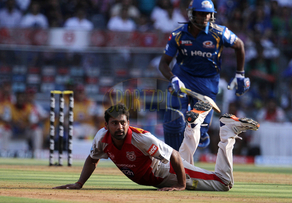 Kings XI Punjab player Praveen Kumar dives to stop the ball during match 28 of the Indian Premier League ( IPL) 2012  between The Mumbai Indians and the Kings X1 Punjab held at the Wankhede Stadium in Mumbai on the 22nd April 2012..Photo by: Vipin Pawar/IPL/SPORTZPICS