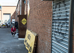 East Dumbartonshire candidate Jo Swinson on the campaign trail in Crossveggate, beside a slightly inappropriate bit of grafitti (Legalise Cannabis Campaign)<br /> <br /> © Dave Johnston/ EEm
