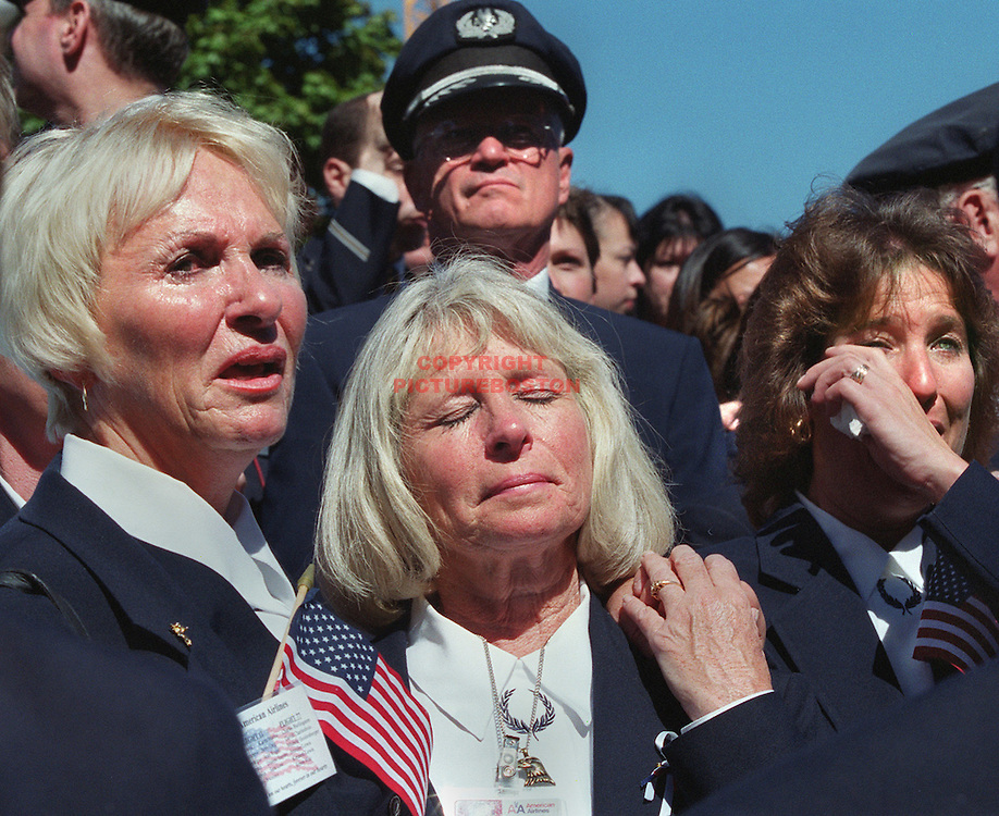 """fragm  """"Airline Employee Remebrance""""  At City Hall Plaza-3 American Airlines Flight Attendants LTOR Bette Langlais,Mickey Bulger and Jan Johnson (all next door neighbors in Hampton,NH) cry during Bette Midler's song """"Wind Beneath My Wings"""" at the service in memory of the 22 American and United Airlines employees  that died in flight hitting the WTC in NYC working on Sept 11 2001."""