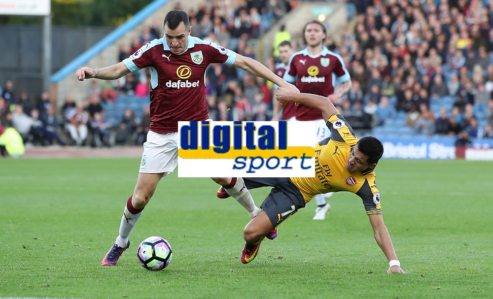 Football - 2016 / 2017 Premier League - Burnley v Arsenal at Turf Moor<br /> <br /> Alexis Sanchez of Arsenal and Dean Marney of Burnley<br /> <br /> <br /> COLORSPORT/LYNNE CAMERON