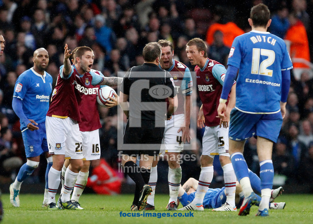 Picture by Daniel Chesterton/Focus Images Ltd. 07966 018899.09/04/12.West Ham players protest a decision to referee Jonathan Moss during the Npower Championship match at the Boleyn Ground stadium, London.