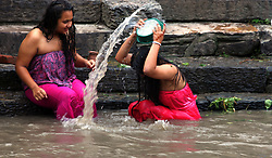 September 6, 2016 - Kathmandu, Nepal - Hindu women take a bath ritual by using Dattiwan (sacred twigs) during Rishi Panchami festival on the bank of Bagmati river. Rishi Panchami, also known as Bhadraprada Sukla Panchami, is the last day of Teej Festival.On the occasion, women take a bath early in the morning to mark Rishi Panchami and seek forgiveness for 'sins' committed during monthly periods.Hindu women offer prayers to Saptarshis  (Credit Image: © Archana Shrestha/Pacific Press via ZUMA Wire)