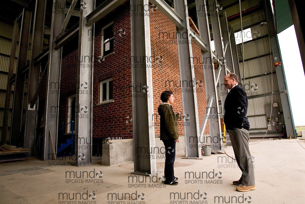 London, Ontario ---06/9/28--- Professor Mike Bartlett and colleague  Lizeanne St. Pierre talk at the Three Little Pigs facility; a two story, suburban-style test house built inside a large hanger like building near the airport in London, Ontario. The facility will test the forces applied to structures in a simulated hurricane..GEOFF ROBINS The Globe and Mail<br />