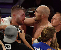 LAS VEGAS, NEVADA - JUNE 15: Tyson Fury(R) talks with Tom Schwarz after the fight was stop in the second round fight at MGM Grand Garden Arena on June 15, 2019 in Las Vegas, Nevada. Tyson Fury took the win by took the win by TKO. MB Media