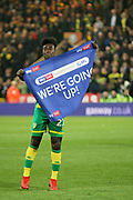 Norwich City midfielder Alexander Tettey (27) celebrates with EFL flag after the EFL Sky Bet Championship match between Norwich City and Blackburn Rovers at Carrow Road, Norwich, England on 27 April 2019.