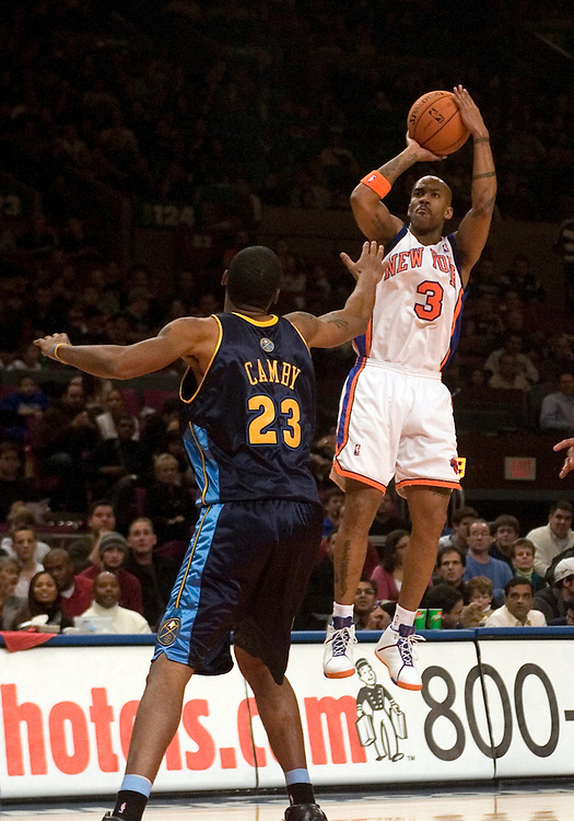 Stephon Marbury of the New York Knicks takes a jump shot over Marcus Camby of f the Denver Nuggets at Madison Square Garden, New York on Saturday  16 December 2006. (Andrew Gombert for The New York TImes)<br />