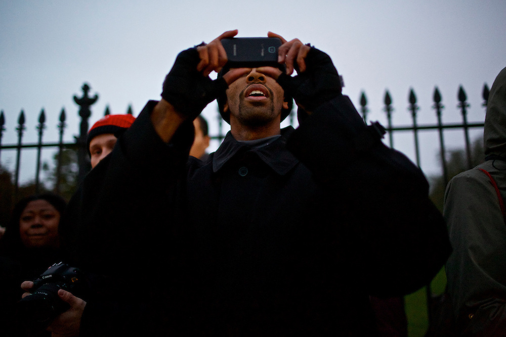Dale Taylor, a student at American University, waits outside the White House to catch a glimpse of President Barack Obama on Wednesday, Nov. 7, 2012 in Washington, D.C.