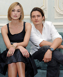 Keira Knightley and Orlando Bloom pose for photographs after holding a press conference to promote their new film, Pirates Of The Carribean: Dead Man's Chest, at Claridges, central London.
