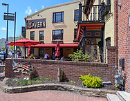 Fells Point, Baltimore, MD, USA -- April 13, 2019. Wide-angle shot of the exterior of Fells Point Tavern on Thames St in historic Fells Point, Baltimo