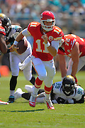 Kansas City Chiefs quarterback Alex Smith (11) runs upfield during the Chiefs 28-2 win over the Jacksonville Jaguars at EverBank Field on Sept. 8, 2013 in Jacksonville, Florida. The <br /> <br /> ©2013 Scott A. Miller