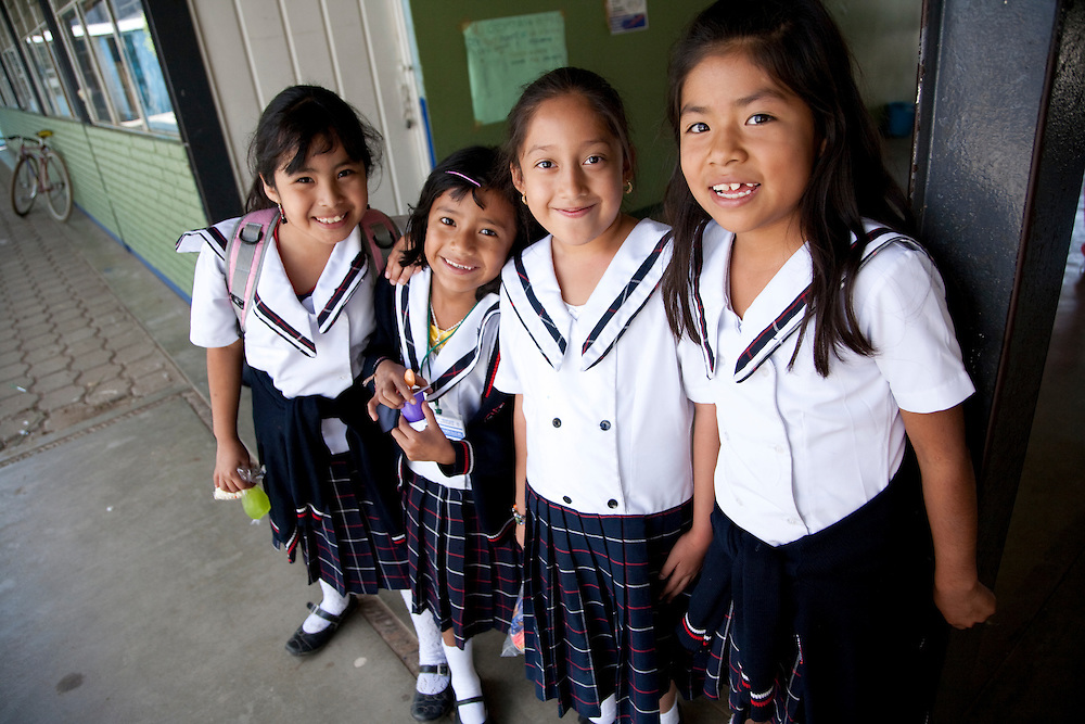 North America, Mexico, Oaxaca Province, Zaachila, girls in school uniforms
