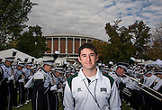 Gary Dillabaugh III poses for a portrait beside the Marching 110 performance during the Miami vs. OU football game tailgate party.  Photo by Elizabeth Held