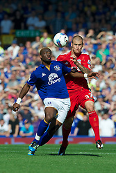 LIVERPOOL, ENGLAND - Saturday, October 1, 2011: Liverpool's Martin Skrtel in action against Everton's Louis Saha during the Premiership match at Goodison Park. (Pic by David Rawcliffe/Propaganda)