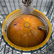 Top of Second Stage Liquid Hydrogen tank, and Saturn V Third Stage J-2 Engine (top). Kennedy Space Center.