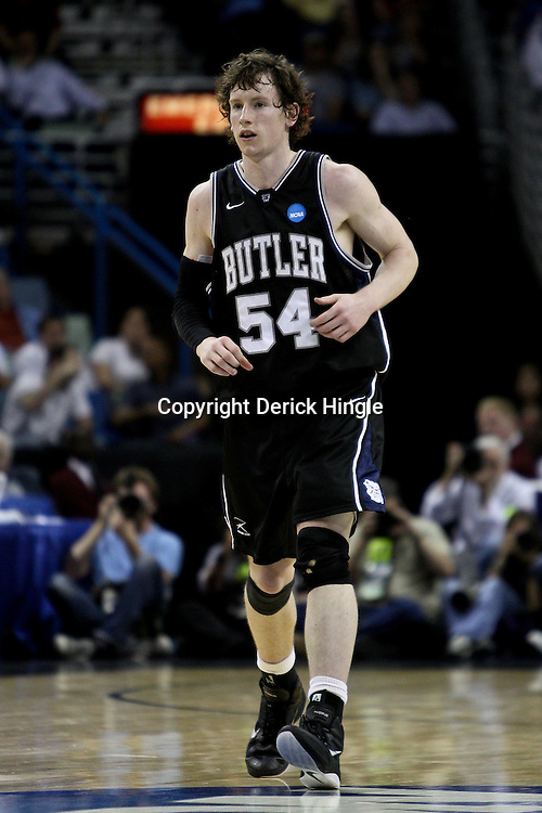Mar 24, 2011; New Orleans, LA; Butler Bulldogs forward Matt Howard (54) reacts after a three point basket during the first half of the semifinals of the southeast regional of the 2011 NCAA men's basketball tournament against the Wisconsin Badgers at New Orleans Arena.  Mandatory Credit: Derick E. Hingle