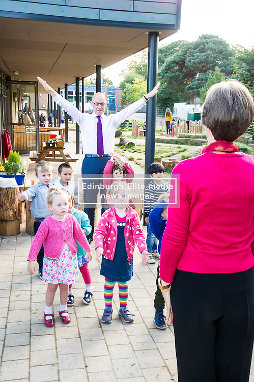 Pictured: John Swinney was not very good at following teacher Rena Swinton's instructions during the warm up for the day<br /> <br /> Education Secretary John Swinney MSP met staff and children at Davidson's Mains Primary School nursery today as he reaffirmed his commitment to the transformation of early learning and childcare. <br /> <br /> Ger Harley: 6 September 2018
