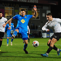 TELFORD COPYRIGHT MIKE SHERIDAN Adam Walker of Telford sees a shot charged down during the FA Trophy Round 1 fixture between AFC Telford United and Leamington at the New Bucks head Stadium on Tuesday, December 17, 2019.<br /> <br /> Picture credit: Mike Sheridan/Ultrapress<br /> <br /> MS201920-034