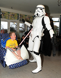 Star Wars, Rachel House, Kinross, 11-12-2016<br /> <br /> People dressed as Star Wars characters to visit children's hospice. Edinburgh 's Capital Sci-Fi Con organiser Keith Armour and other delegates to don costumes and visit children and their families at Rachel House.<br /> <br /> McKenzie takes on a Storm Trooper<br /> <br /> (c) David Wardle | Edinburgh Elite media