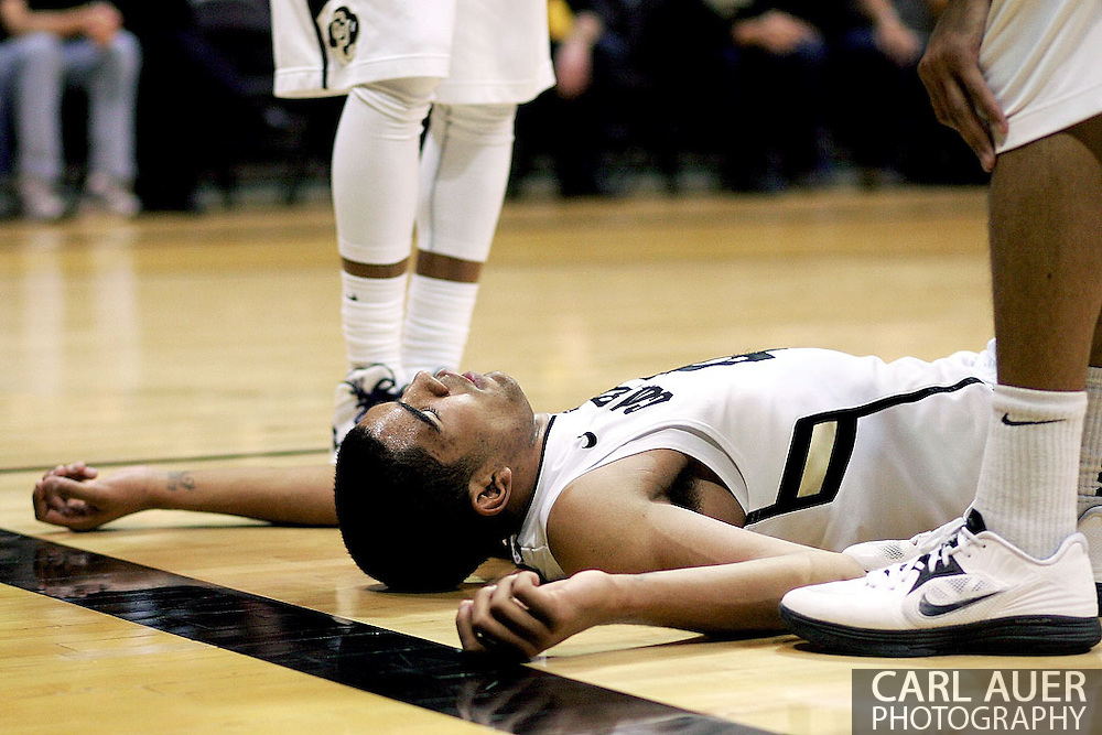 February 16th, 2013 Boulder, CO - Colorado Buffaloes freshman forward Josh Scott (40) lies on the ground unconscious after taking an elbow to the head on a rebound attempt early in the second half of action in the NCAA basketball game between the Arizona State Sun Devils and the University of Colorado Buffaloes at the Coors Events Center in Boulder CO