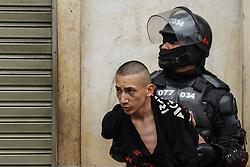 59594095  . A Policeman arrests a man during a protest in commemoration of the International Labour Day in Bogota, capital of Colombia, May 1, 2013,  May 2, 2013 Photo by: i-Images.UK ONLY