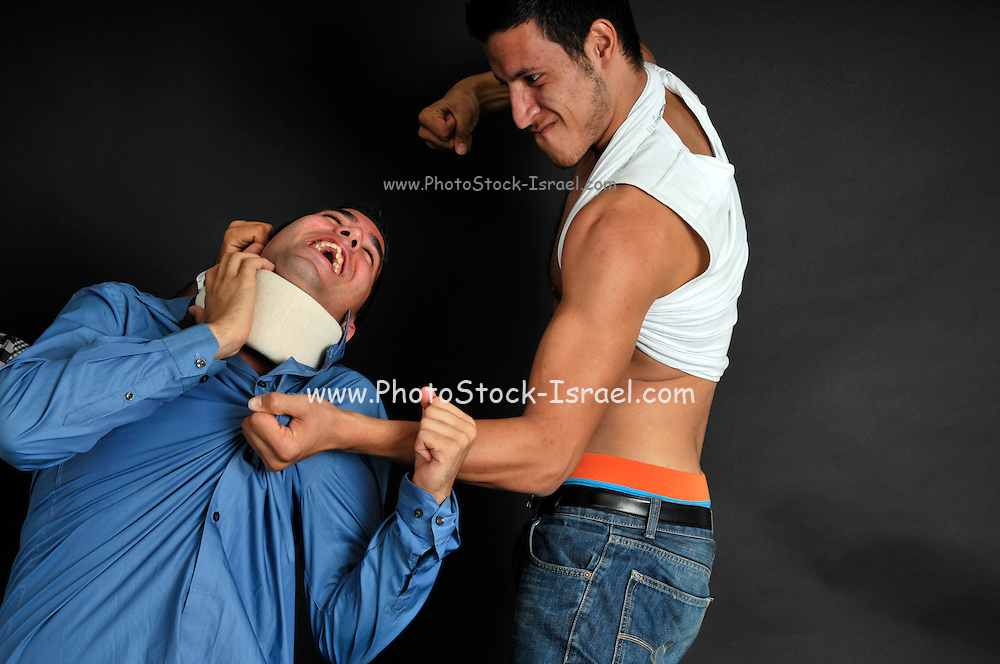Violence. The neighbourhood bully bits up another man
