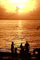 fishing at sunset above  Sosua Beach, Dominican Republic..Photo by Owen Franken.