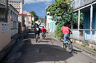 Boys on bicycles in Basseterre the capital of St Kitts, Leaward Islands, The Caribbean