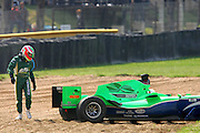 JOHANNESBURG, SOUTH AFRICA -  22 February 2009, Adam Carrol of Team Ireland looks at his car after spinning off at turn 4 during the Feature Race of the A1GP held at Kyalami Motor Racing Circuit in Johannesburg, Gauteng, South Africa......Photo by SPORTZPICS