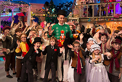 Repro Free: Embargoed till 30th November Repro Free:<br /> Ryan Tubridy with the performers on set of the Late Late toy Show 2013. Pic Andres Poveda
