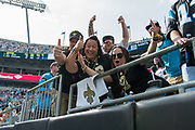 Happy Saints fans celebrate the New Orleans Saints 34 to 13 victory over the Carolina Panthers.