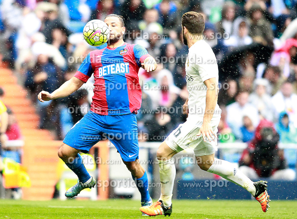 17.10.2015, Estadio Santiago Bernabeu, Madrid, ESP, Primera Division, Real Madrid vs Levante UD, 8. Runde, im Bild Real Madrid's Nacho Fernandez (r) and Levante UD's Nabil Ghilas // during the Spanish Primera Division 8th round match between Real Madrid and Levante UD at the Estadio Santiago Bernabeu in Madrid, Spain on 2015/10/17. EXPA Pictures &copy; 2015, PhotoCredit: EXPA/ Alterphotos/ Acero<br /> <br /> *****ATTENTION - OUT of ESP, SUI*****