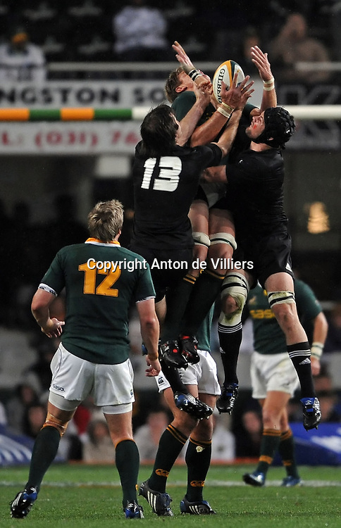 Richie McCaw (c) and Conrad Smith of the All Blacks and Juan Smith of the Springboks compete for the ball in the air.<br /> Rugby - Tri-Nations - 090801 - South Africa v New Zealand - ABSA Stadium - Durban - South Africa. The Springboks won 31-19.<br /> Photographer : Anton de Villiers / SASPA
