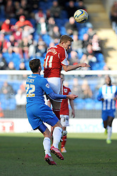 Bristol City's Scott Wagstaff wins a header against Colchester United's Alex Gilbey - Photo mandatory by-line: Dougie Allward/JMP - Mobile: 07966 386802 22/03/2014 - SPORT - FOOTBALL - Colchester - Colchester Community Stadium - Colchester United v Bristol City - Sky Bet League One