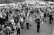 Crowds on street near police barricade, Reclaim the Streets, Shepherd's Bush, London, July 1996