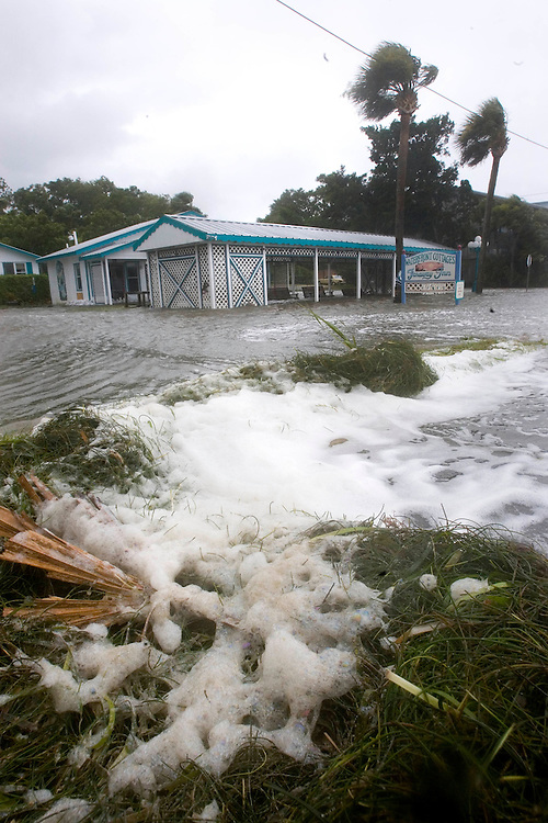 Seaweed piles up in front of the Faraway Inn in Cedar Key, Florda  as the surge from Tropical Storm Alberto comes ashore June13, 2006. REUTERS/Scott Audette