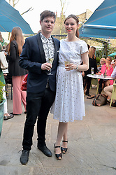 PICTURE SHOWS:-SOPHIE ELLIS-BEXTOR and RICHARD JONES.<br /> Tuesday 14th April 2015 saw a host of London influencers and VIP faces gather together to celebrate the launch of The Ivy Chelsea Garden. Live entertainment was provided by jazz-trio The Blind Tigers, whilst guests enjoyed Moët & Chandon Champagne, alongside a series of delicious canapés created by the restaurant's Executive Chef, Sean Burbidge.<br /> The evening showcased The Ivy Chelsea Garden to two hundred VIPs and Chelsea<br /> residents, inviting guests to preview the restaurant and gardens which marry<br /> approachable sophistication and familiar luxury with an underlying feeling of glamour and theatre. The Ivy Chelsea Garden's interiors have been designed by Martin Brudnizki Design Studio, and cleverly combine vintage with luxury, resulting in a space that is both alluring and down-to-earth.