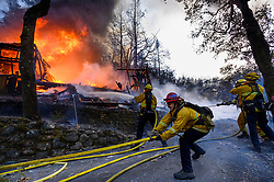 October 29, 2019, Sonoma County, California, USA: Firefighters battle a home on fire along Highway 128 during the Kincade Fire in Sonoma County on Tuesday. The Kincade Fire has damaged 16 structures and destroyed another 96 in the county. Sonoma is under a state of emergency, and 185,000 people have been evacuated. (Credit Image: © Paul Kitagaki Jr./ZUMA Wire)