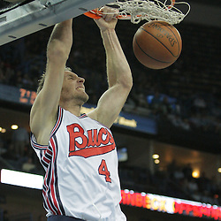 10 December 2008:  New Orleans Hornets forward Sean Marks (4) dunks the ball during a NBA regular season game between the Charlotte Bobcats and the New Orleans Hornets at the New Orleans Arena in New Orleans, LA. The game was an NBA Hardwood Classic with the Hornets dressed out in throwback uniforms honoring the former ABA franchise the New Orleans Buccaneers..