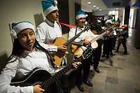 Members of the Alisal Center for the Fine Arts Rondalla Guitar Ensemble wait to make their entrance at the December 5th, 2017 opening of the Stories from Salinas exhibition at the CSUMB Salinas Center for Arts and Culture in Oldtown. The exhibition celebrates the mentors, youth and families of the Salinas Youth Initiative.